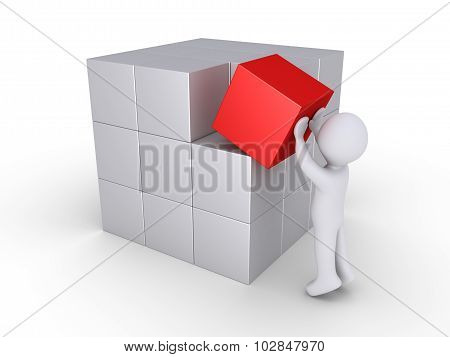 Person Finalizing Cube Construction