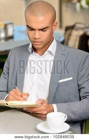 Handsome businessman making notes