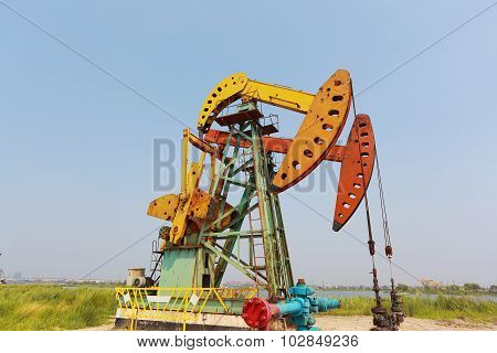 Golden Yellow And Red Oil Pump Of Crude Oilwell Rig