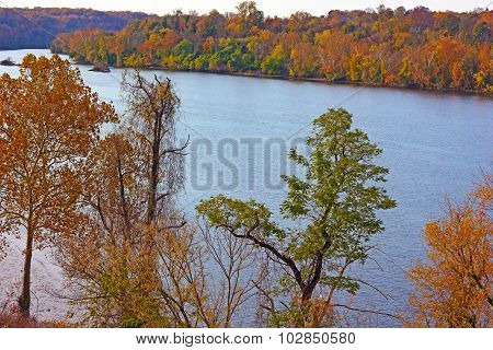 Potomac River with trees in autumn colors in Washington DC USA.