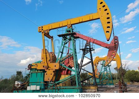 Golden Yellow And Pink Oil Pump Of Crude Oilwell Rig
