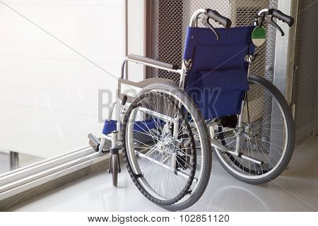 Empty Wheelchair Parked In Airport