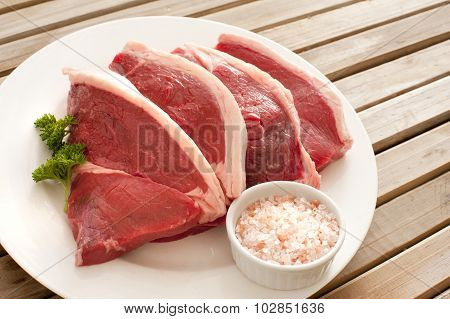 Four Uncooked Succulent Beef Steaks
