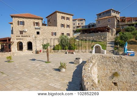ULCINJ, MONTENEGRO - JULY 11, 2015: luxury hotel and restaurant in the Ulcinj old city walls - Stari Grad - where every stone represents a piece of history.