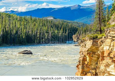 Majestic mountain river in Canada. Athabasca River, Banff, Alberta.
