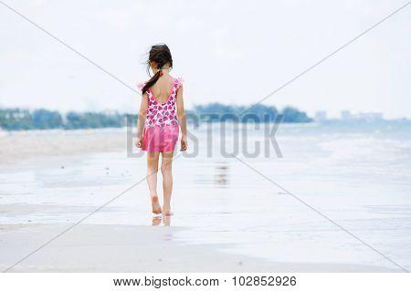 Little Asian Girl Walk On The Beach