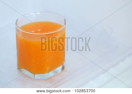 glass of fresh orange juice in refrigerator