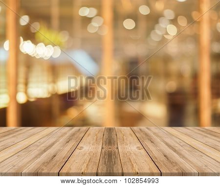 Wooden Board Empty Table blur in coffee shop - can be used for display or montage your products.