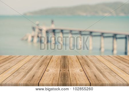 Wood Table Top On Blurred Blue Sea And White Sand Beach Background, Vintage Tone.
