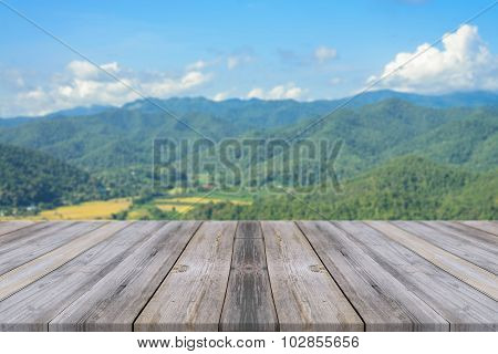 Wooden Board Empty Table blur mountain in forest - can be used for display or montage your products.