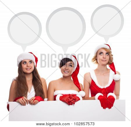 Three Young Santa Helper Girl With Thinking Ballon And Empty Board