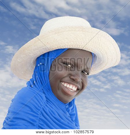 Muslim girl wearing a straw hat, ten years old