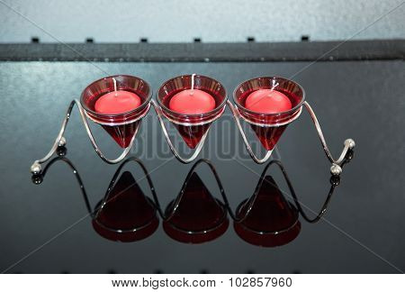 Modern red candlestick with three candles