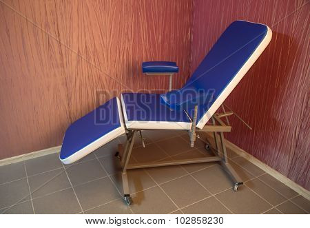 Blue medical chair for cosmetology