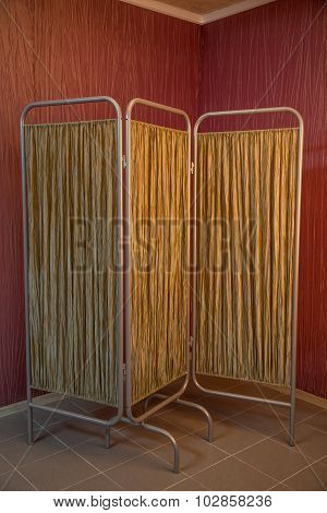 Fabric folding screen with a metal frame