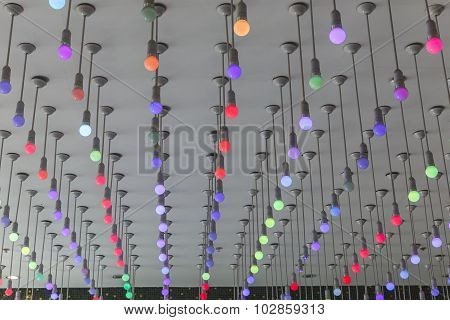 Installation Of Multi-colored Light Bulbs On The Ceiling
