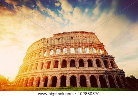 Colosseum in Rome, Italy. Symbol of the ancient city. Amphitheatre in sunrise light. Vintage