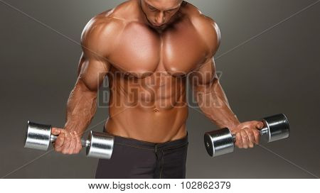 athletic man bodybuilder doing exercises with dumbbell