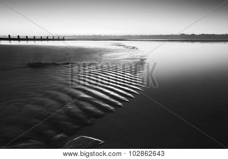 Beautiful Low Tide Beach Vibrant Sunrise In Black And White