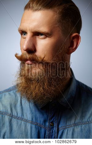 Bearded man. Handsome man with a beard and twirled mustache.