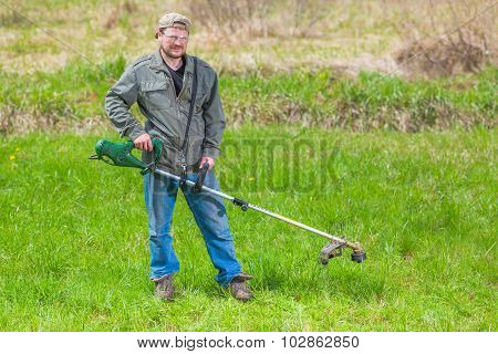 Lawnmower man green field cultivating rural country