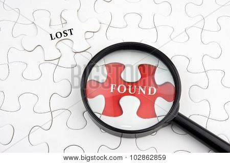 Magnifying Glass On Missing Puzzle With