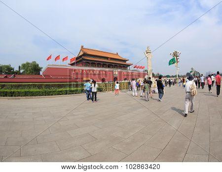 Tourists on Tiananmen square near Forbidden City