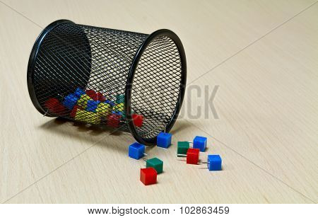 Paper Tack And Black Basket On The Wood Background.