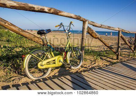 Nice retro vintage bicycle near beach, sunny day