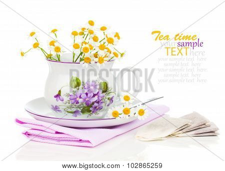 Cup With Fresh Camomile Flower And Tea Bags, Isolated On White