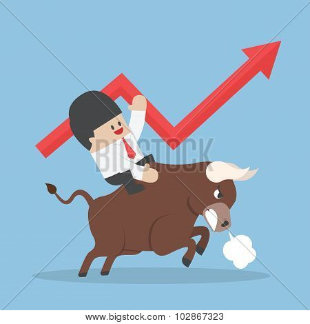 Businessman Riding On Bull