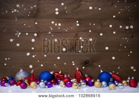 Colorful Christmas Balls As Decoration On Snow, Snowflakes