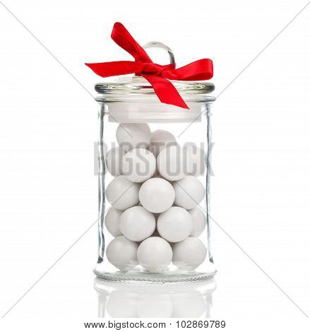 White Candies, Gumballs In Glass Jar, Over White Background