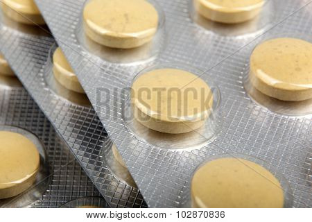 Pile Of Colorful Medicine Pills And Capsules In Blister Packs