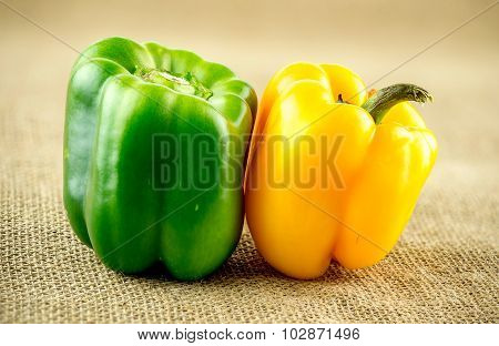 Macro Closeup Of Green And Yellow Bell Peppers On Farmhouse Background