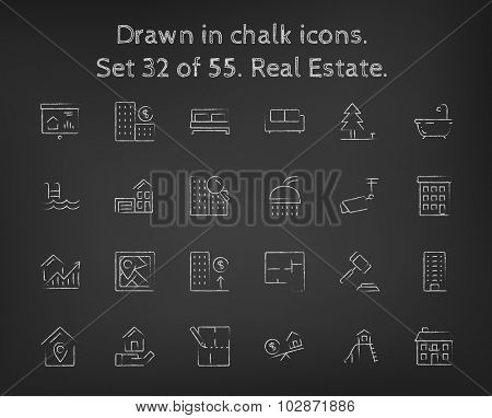 Real estate icon set hand drawn in chalk on a blackboard vector white icons on a black background.