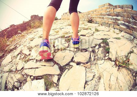 ftiness woman runner legs running on great wall