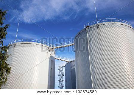 Fuel, Oil Tanks Against Blue Sky