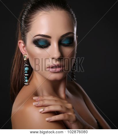 Sexy Girl With Dark Hair And Evening Makeup With Bijou