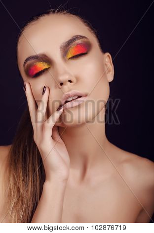 Beautiful Girl With Blond Hair And Extravagant Bright Makeup