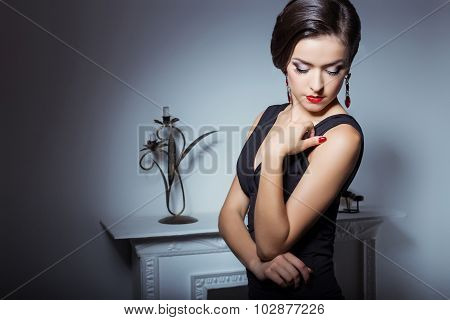 beautiful elegant attractive sexy girl in evening dress with hairstyle and bright makeup is evening