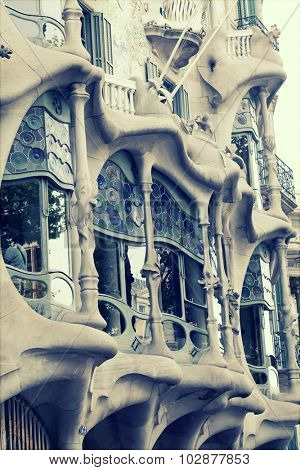 BARCELONA - MAY 2, 2015: The facade of the house Casa Battlo (also could the house of bones) designed by Antoni Gaudi­ with his famous expressionistic style