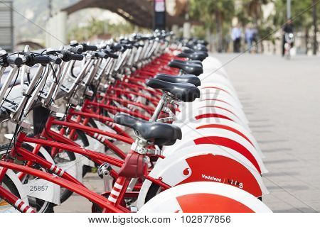 BARCELONA, SPAIN - APRIL 30, 2015: Group of bicycles in the row. Bikes for rent docking station.