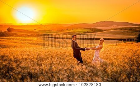 Newlyweds And Tuscan Landscape