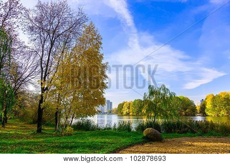 Autumn Scenery With Trees And Lake In The Urban Park