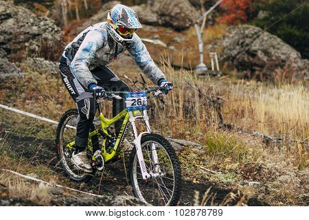 racer cyclist riding along the earthen trail