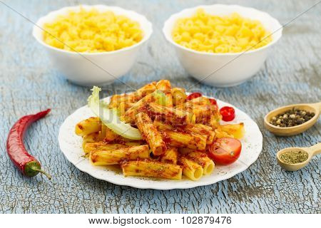 White Plate Of Pasta With Tomato Sauce On Wooden Background. Healthy Diet. Ingredients For Cooking P