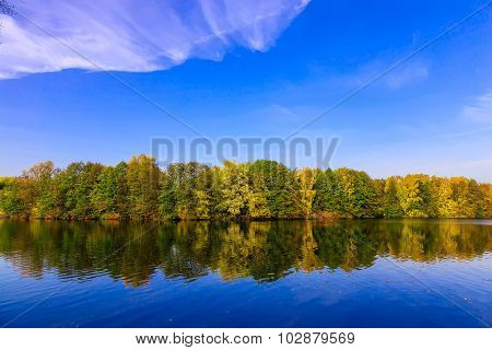 Nature With Lake And Multicolored Trees In Autumn Time