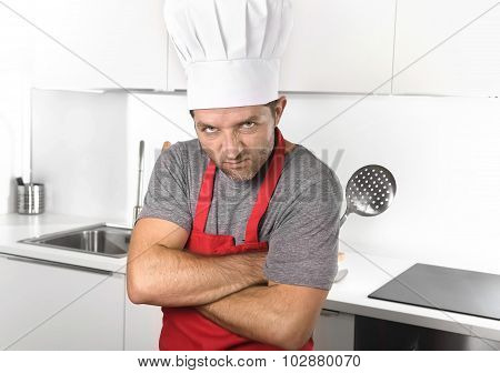 Man Holding Skimmer And Rolling Pin In Apron And Cook Hat At Hom