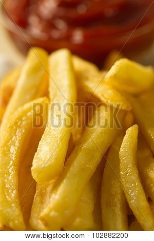 French Fries With Fresh Ketchup On A Paper Bag
